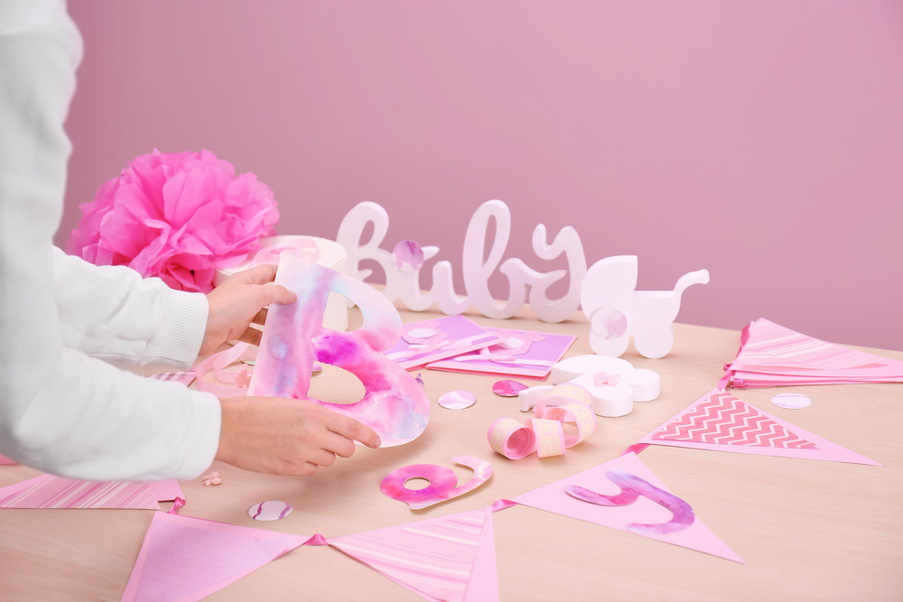 woman preparing decorations baby shower for a girl